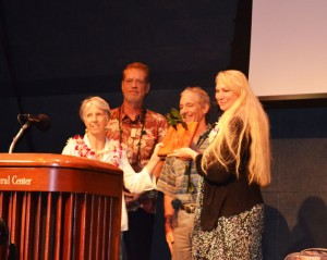 Christina Chang of Lokelani Ohana, a farm in Waihee, Maui, accepts the Malama i ka Aina Award. Presenters from left to right are Teya Penniman of MISC, Cas Vanderwoude of the Hawaii Ant Lab. and Rob Parsons with the County of Maui. Chang was recognized for her efforts to stop the spread of the little fire ant on Maui.