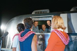 No hugs and kisses yet. The astronauts on Apollo 11 spent nearly 2 weeks in a quarantine facility when they returned from their moon landing to ensure they were not carrying any lunar microorganisms. Looking through the window (left to right) Astronauts Neil Armstrong, Edwin Aldrin Jr., and Michael Collins. The wives are (left to right) Mrs. Pat Collins, Mrs. Jan Armstrong, and Mrs. Jean Aldrin. Photo Courtesy NASA.