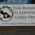 Signage indicating the coqui-free status of a local business.